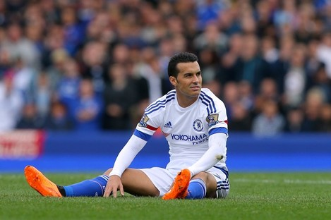 Chelsea's Pedro sits dejected on the turf during his team's loss to Everton on Saturday.