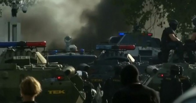 Chaos as Hungarian police fire tear gas and water cannon at migrants