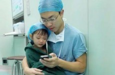 This picture of a doctor comforting a little girl before surgery will give you the feels