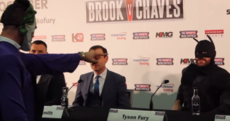 Boxer inexplicably dressed as Batman fights 'The Joker' at heavyweight title press conference