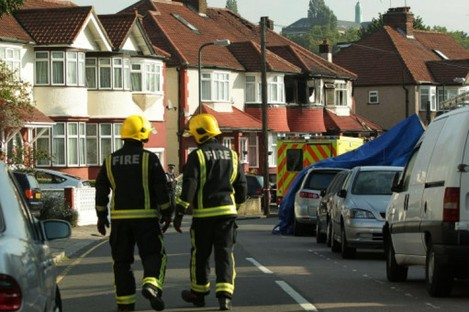 Firefighters at the scene of the fatal fire at Sonia Gardens, Neasden, London.
