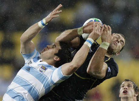 Argentina's Martin Rodriguez, left, and Scotland's Sean Lamont leap to take a catch.