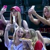 These girls are going viral for completely ignoring a game to take selfies
