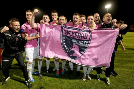 The triumphant Youths team after securing the title and promotion.