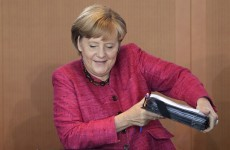 Merkel warns against Greek default - but says 'firewall' is needed
