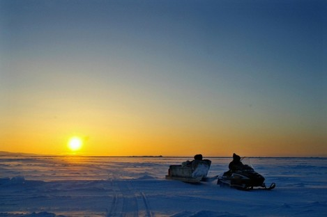 File photo: Inuit hunters drive across Frobisher Bay in front of the arctic horizon
