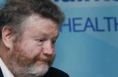 James Reilly had to abandon his car after it was surrounded by protesters