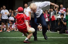 London Mayor Boris Johnson flattens Japanese 10-year-old playing touch rugby