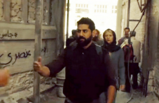 This graffiti in the background of Homeland reads 'Homeland is racist'