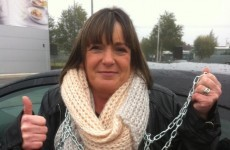 Mother chains herself to government gates to protest son's educational treatment