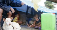 Teenage boy crushed to death as typhoon in Philippines forces thousands to flee