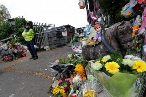 Flowers outside the gates of the halting site where the fire took place, last week.