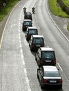 A final farewell: As the bells tolled, five coffins were taken from the hearses