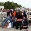Four dead and 44 injured after car strikes US homecoming parade crowd