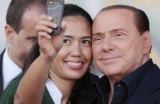 Berlusconi jokes about Hitler, advises young women to marry rich old men