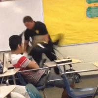 Police officer who threw student across classroom has been sacked