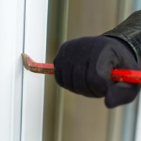 Four armed and masked men break into home of man in his 80s