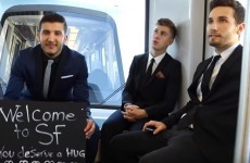 These lads went down to an airport just so they could greet strangers coming off their flights