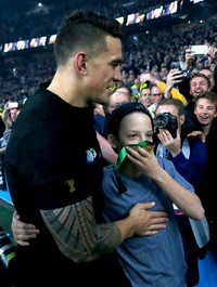 Holy SBW!  Sonny Bill just offloaded his World Cup medal to this lucky kid
