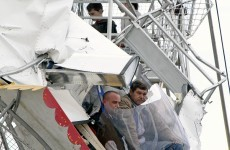 Pictures: four trapped after plane crashes into ferris wheel