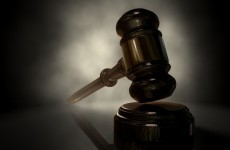 Partner of deceased man denies she knew body was in bedroom wardrobe