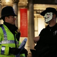 Thousands take to the streets in Guy Fawkes masks in centre of London