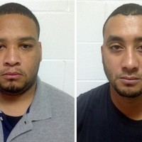 Two officers arrested after six-year-old boy shot dead