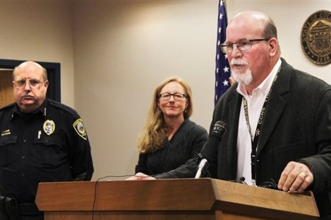 Canon City Police Chief Paul Schultz, left, and Crime Prevention Coordinator Jen O'Connor listen as Superintendent George Welsh talks about a sexting scandal at Canon City High School during a news conference in Canon City.