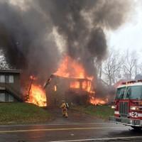 Nine killed after plane crash destroys apartment building