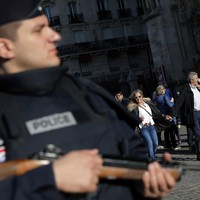 Police are 'still hunting a man involved in Paris attacks'