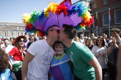 Two men kiss as first results start to filter through in the country's referendum over the legalisation of same-sex marriage.
