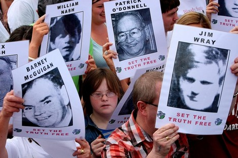 Crowd carry pictures of the victims of Bloody Sunday as the report of the Saville Inquiry was released.