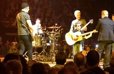 Bono brought up a tiny U2 fan to sing and play guitar on stage in Belfast last night
