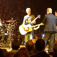Bono brought up a tiny U2 fan to sing and play guitar on stage last night