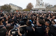 They're singing One Love on the streets of Paris tonight as the city struggles on