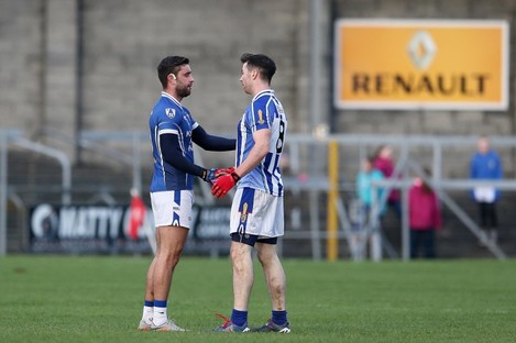 St Loman's Paul Sharry and Michael Darragh MacAuley at full-time.