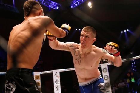 Paul Redmond in action during his win against Alexis Savvidis at Cage Warriors 70 in Dublin in August 2014.