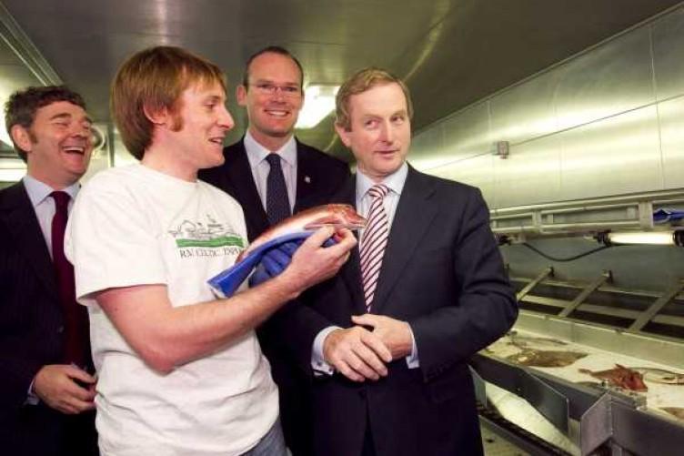 Marine Scientist Macdara O Cuaig shows Enda Kenny a fish on board the Celtic Explorer at the Dublin Docklands.