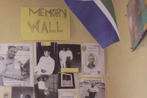 A memorial wall of photos shows well-known gay men and lesbians who have lived and died in Kwa Thema, east of Johannesburg