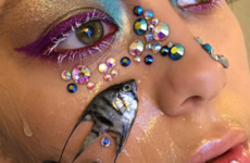 This makeup artist is sticking dead fish to her face