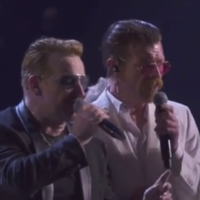 'We will never give up': Eagles of Death Metal join U2 on stage in Paris
