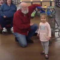 A little girl mistook a man in the supermarket for Santa and he played along