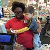 This supermarket cashier's lovely gesture to a toddler is going viral