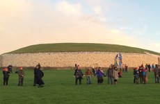 Rain clouds dull winter solstice for crowds at Newgrange