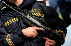 Two arrested after armed gardaí fire on moving car