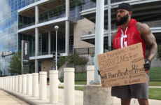 Out of work NFL player gets new job... by holding up a cardboard sign
