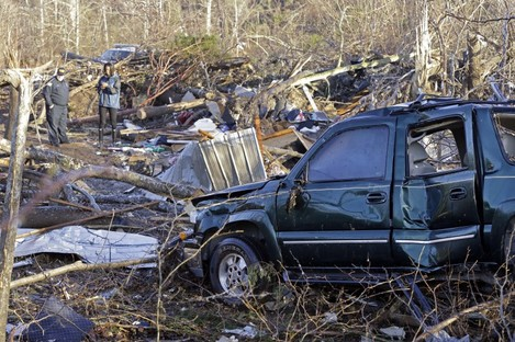 A vehicle sits among debris in an area near Linden, Tennessee.