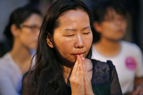 """A woman prays during a memorial for Taiwan's """"comfort women""""."""