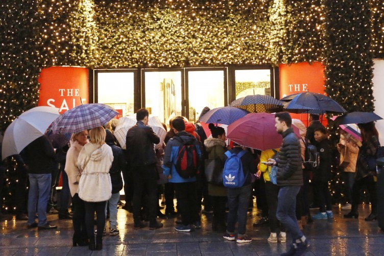 Customers queue for the Brown Thomas winter sale on Grafton Street, Dublin.