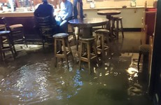 Photo: Two Cork lads sip pints as Storm Frank floods the pub around them